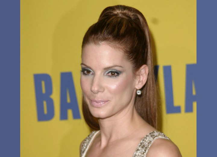 Sandra Bullock wearing her hair up in a high ponytail