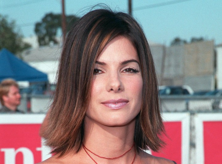 Medium long hair with flipped ends - Sandra Bullock
