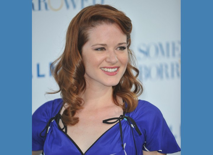 Sara Rue with curled red hair