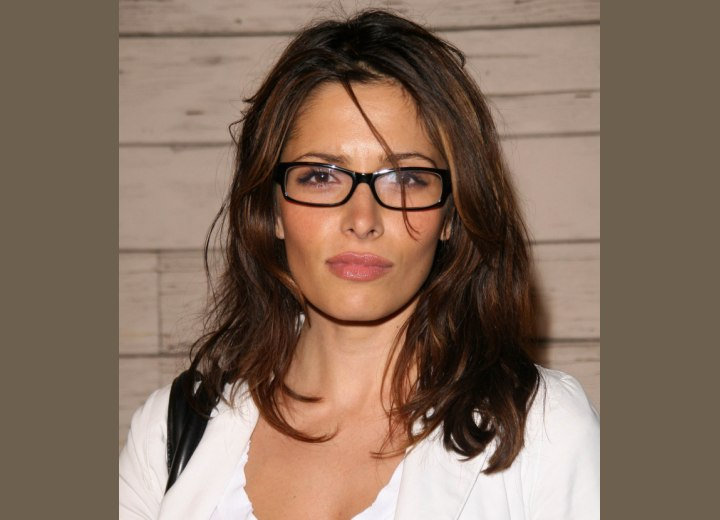 Sarah Shahi with long hair and wearing glasses