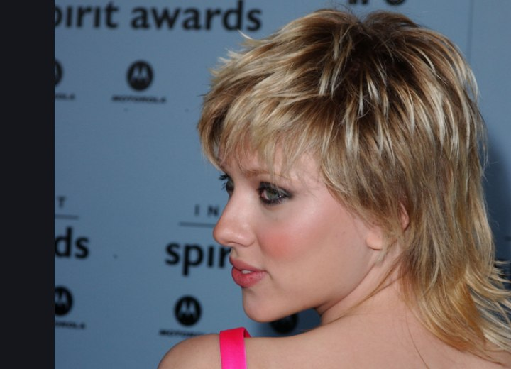 Side view of Scarlett Johansson's short hairstyle with a longer neck area