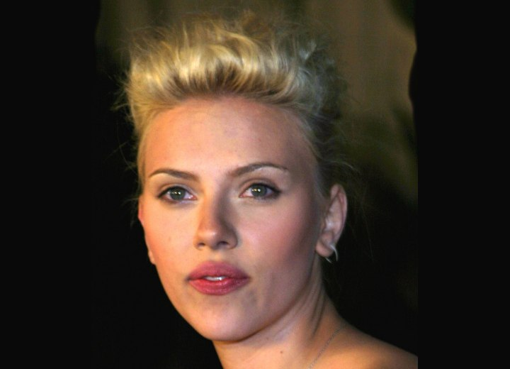 Scarlett Johansson with her hair up and looking short