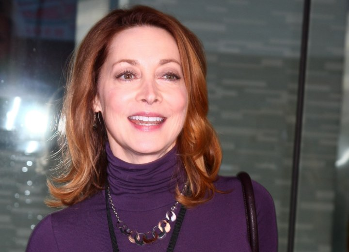 Sharon Lawrence wearing a purple turtleneck