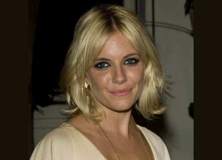 Sienna Miller - Layered mid length hair