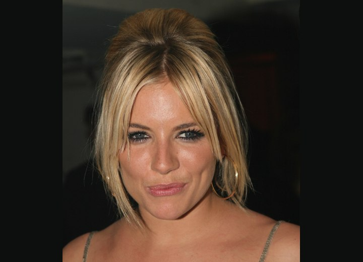 Sienna Miller wearing her hair in an updo