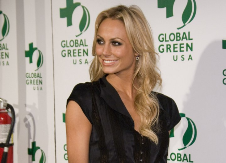 Stacy Keibler wearing her hair very long and wavy