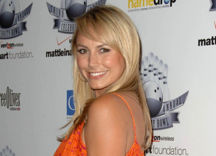 Long blonde hair with swooping bangs - Stacy Keibler