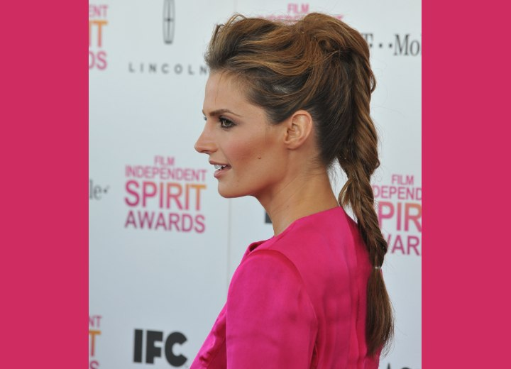 Stana Katic wearing her hair in a ponytail updo