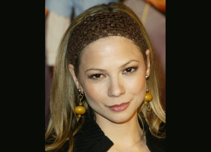 Tamara Braun wearing a head band in her hair