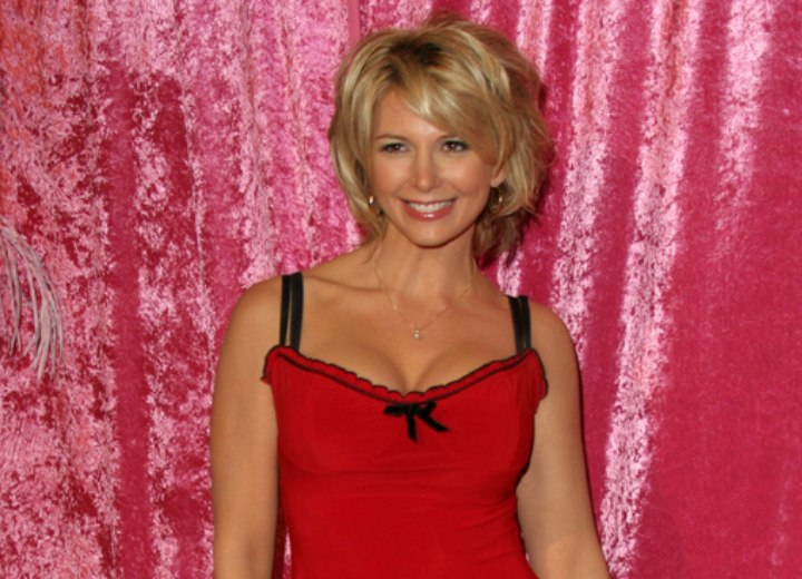 Tamie Sheffield with short hair and wearing a red top