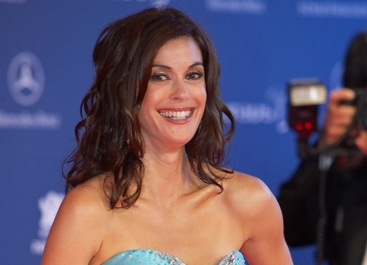 Teri Hatcher with long curled hair