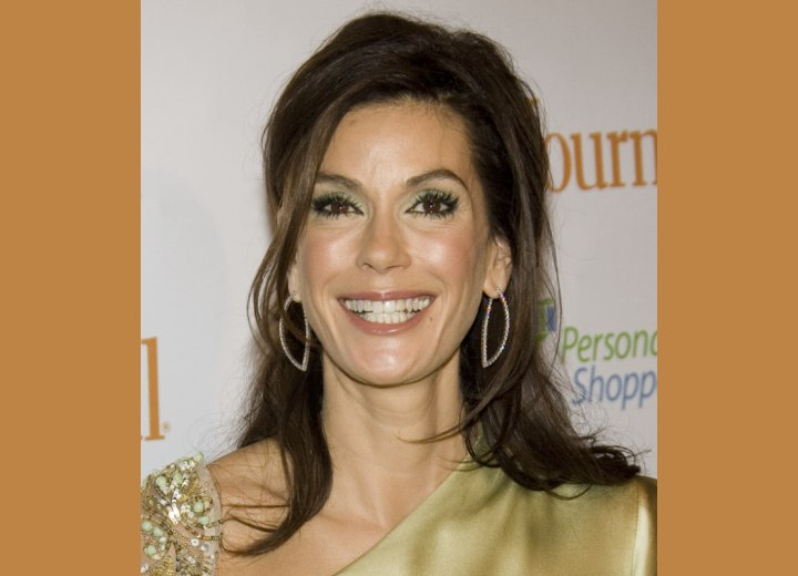 Teri Hatcher wearing her hair gathered in the back