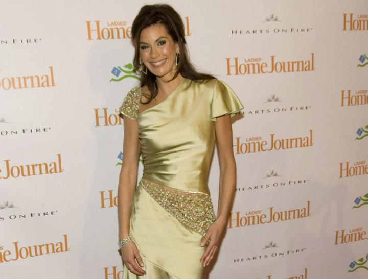 Teri Hatcher wearing a shiny green dress