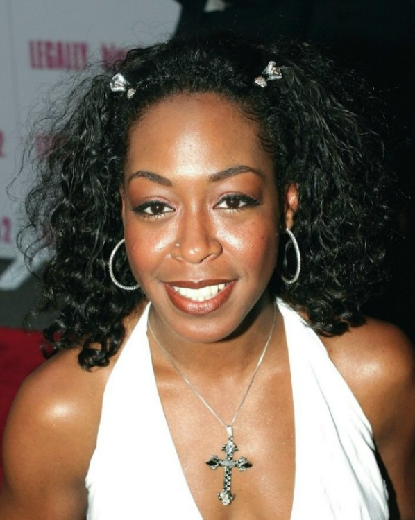 Tichina Arnold Wearing Her Long Hair Curled Into Wavy Riglets