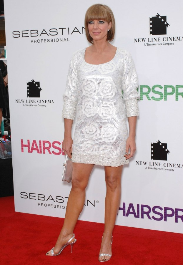 Allison Janney with short hair and wearing a mini dress ...