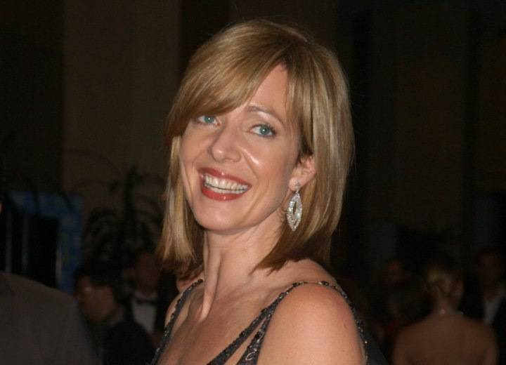Hair with layers to make it thicker and fuller - Allison Janney