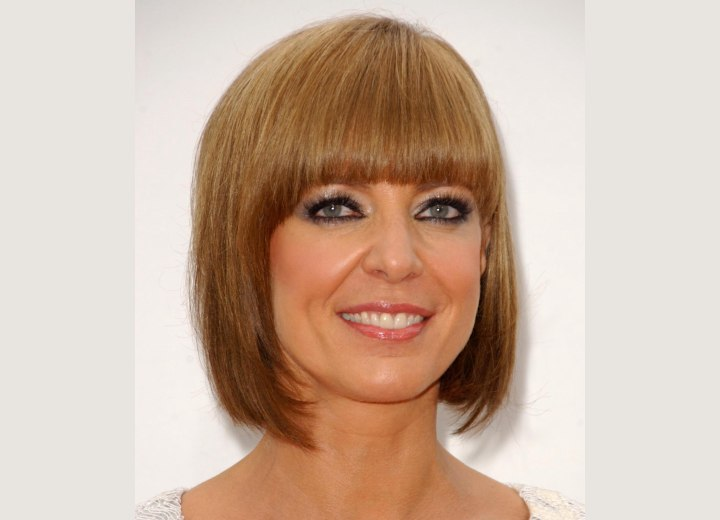 Allison Janney with her hair in a past the chin bob