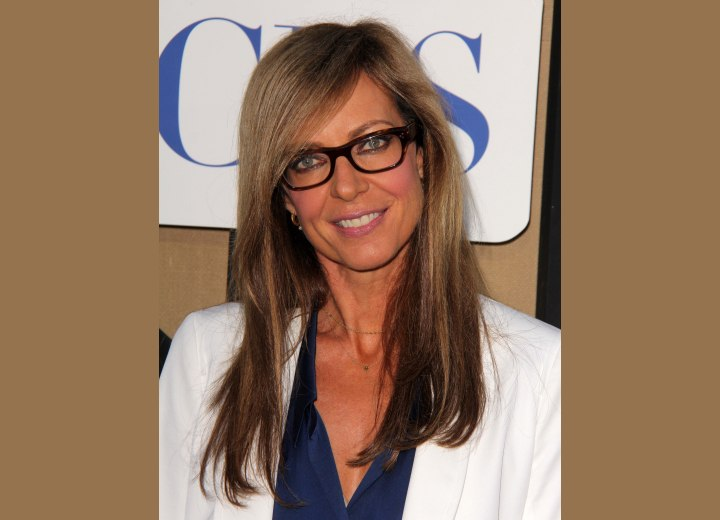 Allison Janney's long hair combined with glasses