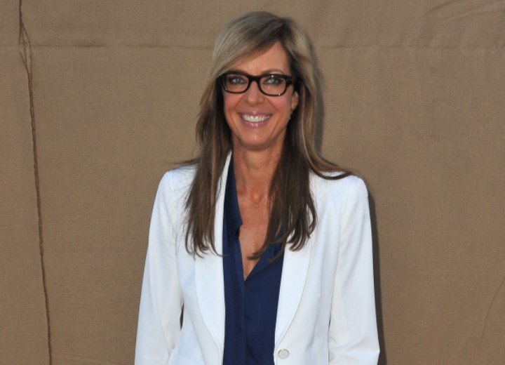 Allison Janney's professional look with silk blouse, blazer and long hair