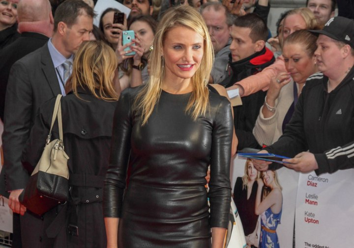 Cameron Diaz wearing a tight black leather dress