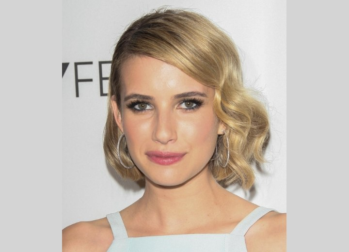 Emma Roberts wearing her hair in a medium length vintage style