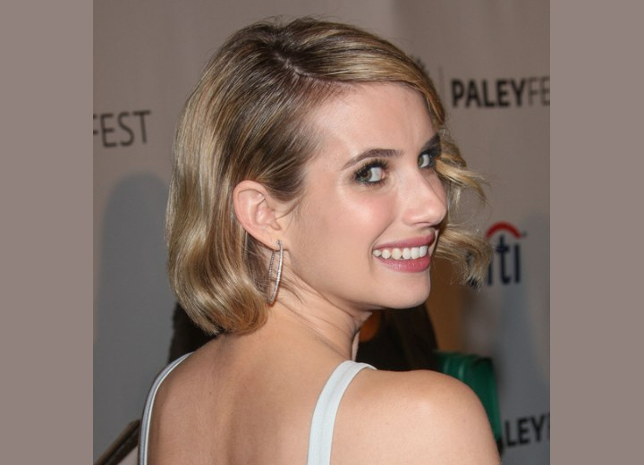 Emma Roberts hairstyle with her hair behind one ear