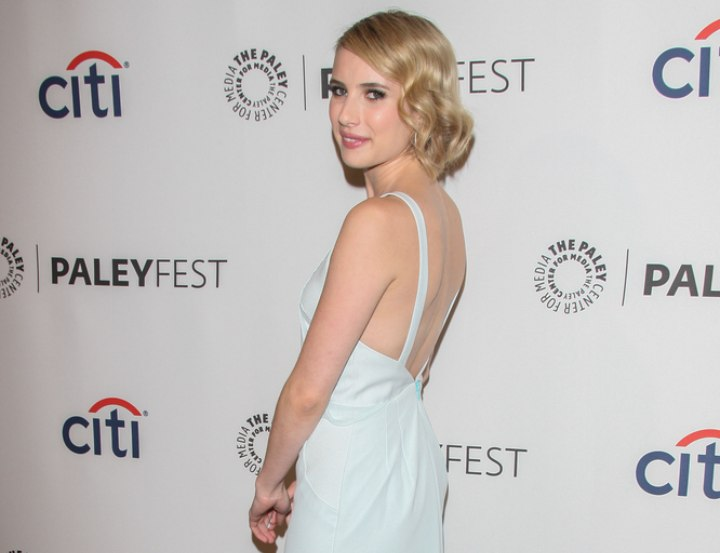 Hair and dress for a vintage look - Emma Roberts