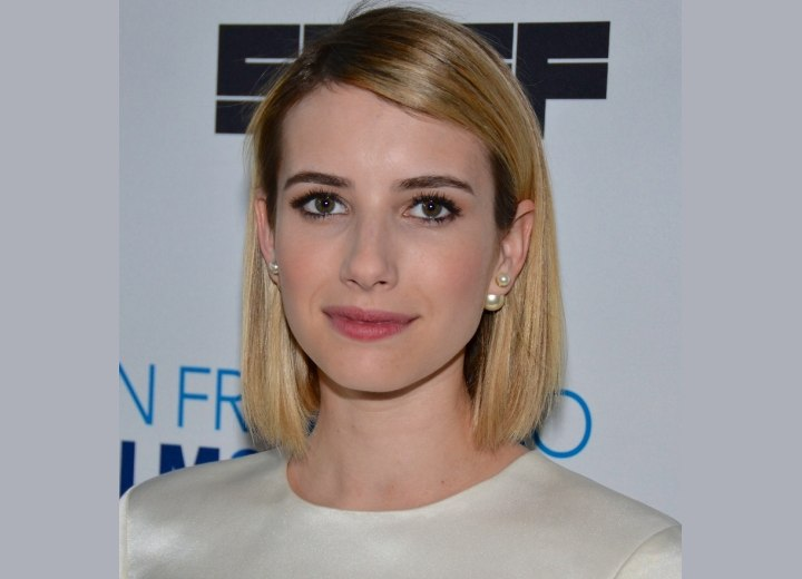 Emma Roberts with her hair cut in a bob with rounded layers