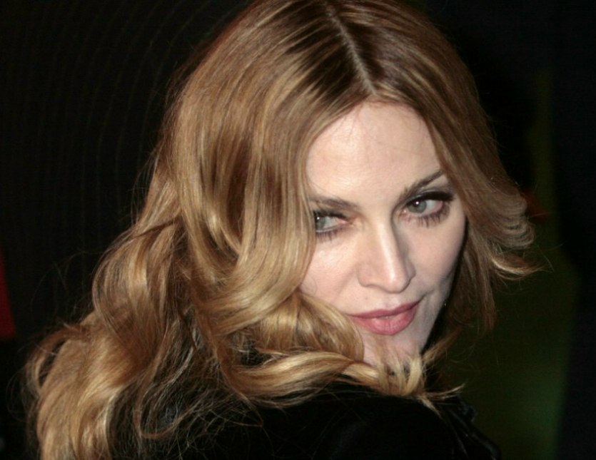 Madonna wearing her long blonde hair with foiled colors - Center Part Hairstyles