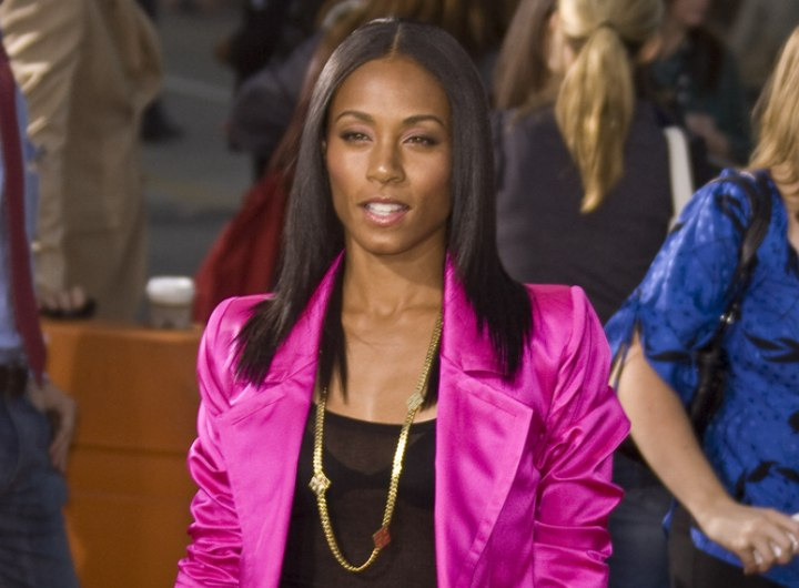 Jada Pinkett Smith wearing a shiny pink suit with shorts
