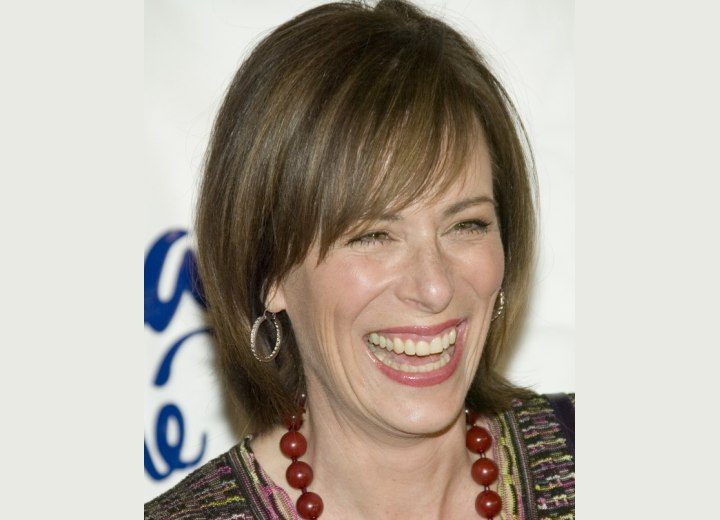 Jane Kaczmarek with smooth short hair