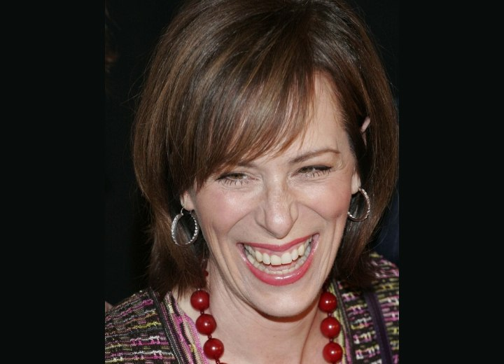 Jane Kaczmarek's warm brown hair color