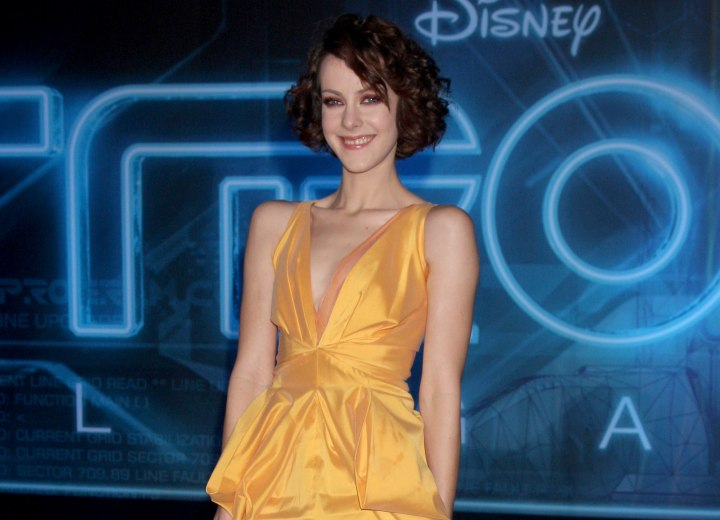 Jena Malone wearing an orange dress