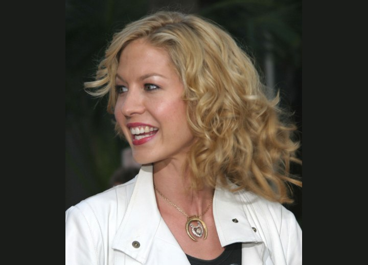 Jenna Elfman with curly layered hair