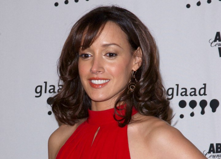 The color tone of Jennifer Beals hair and dress