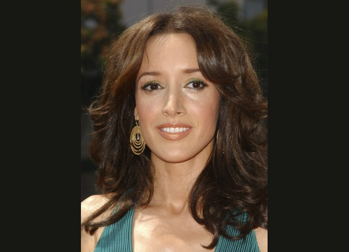 Jennifer Beals long hair with easy curls