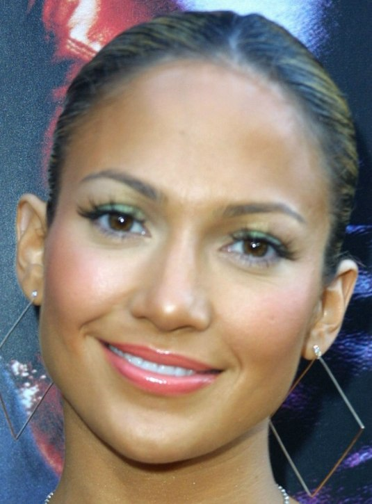 Jennifer lopez sporting a carmen look with her hair pulled back into a