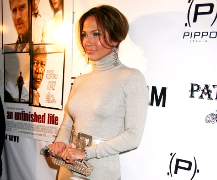 Jennifer Lopez wearing a silver skirt and a gray turtleneck