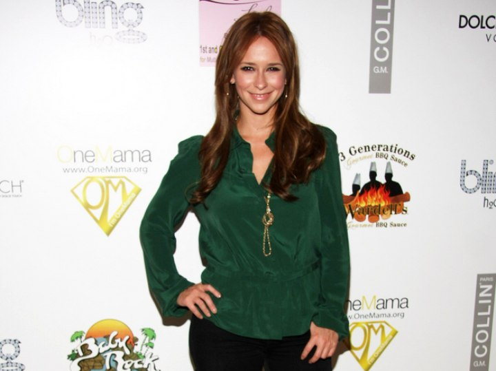 Jennifer Love Hewitt wearing a forest green blouse