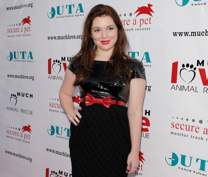 Jennifer Stone wearing a shiny black dress
