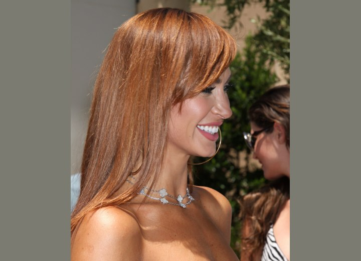 Karina Smirnoff's hair color with browns and reds