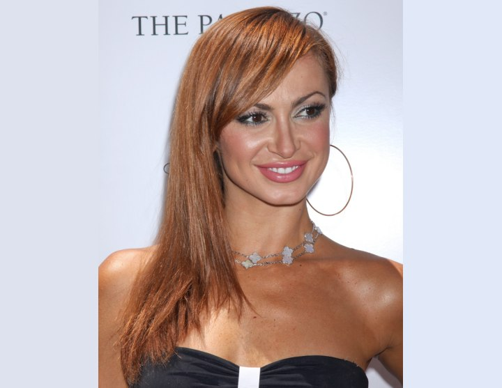 Karina Smirnoff with her hair swung over one shoulder