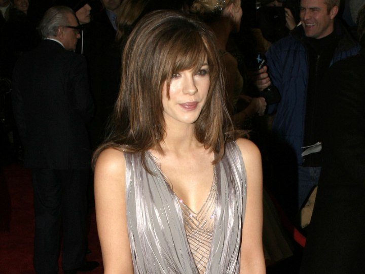 Kate Beckinsale wearing a shiny silver gown