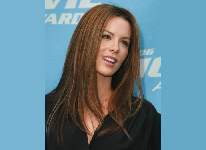 Elegant long hairstyle with a smooth finish - Kate Beckinsale