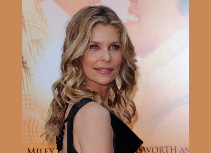 Kate Vernon with long curled hair