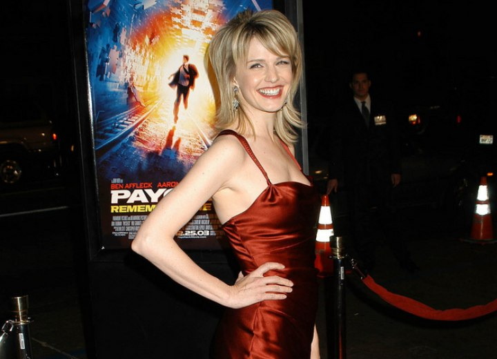 Kathryn Morris wearing a shiny red dress