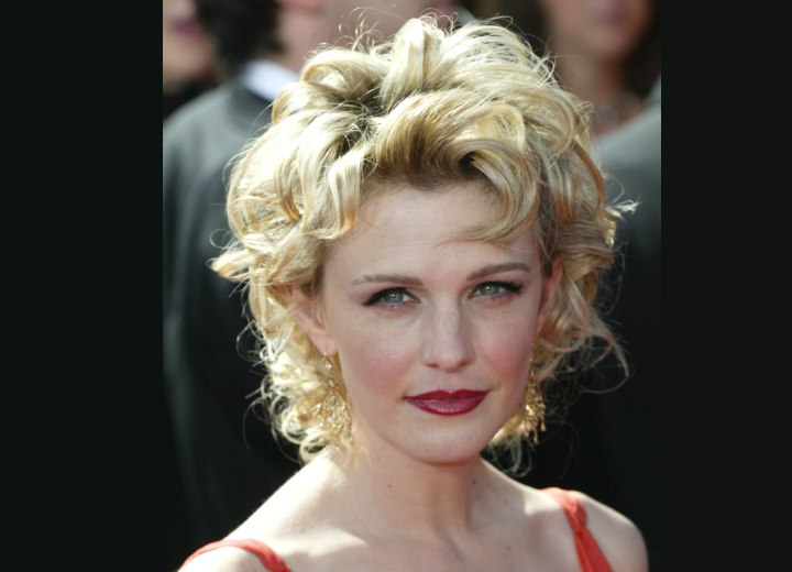 Kathryn Morris with short curly hair