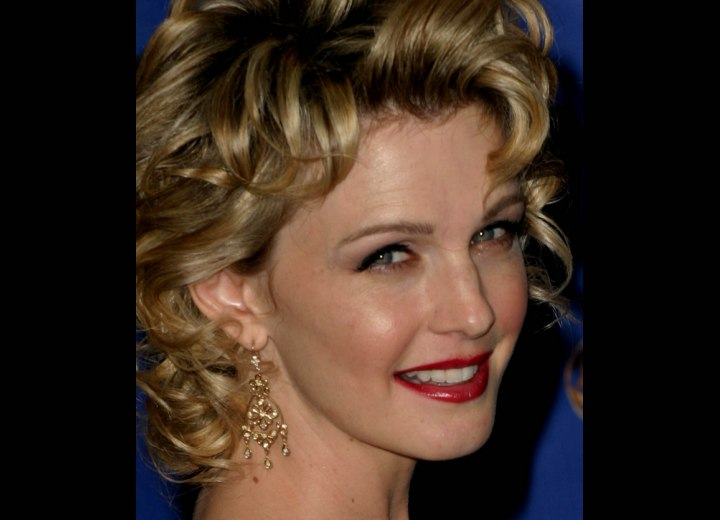 Close up photo of Kathryn Morris curls