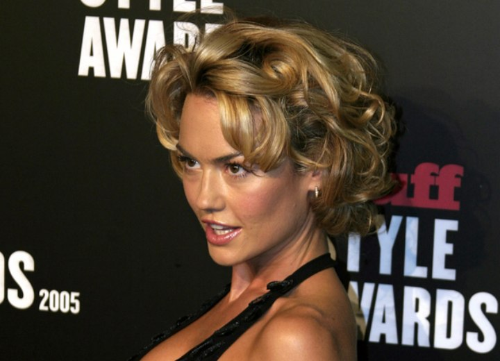 Side view of Kelly Carlson's short curly hairstyle
