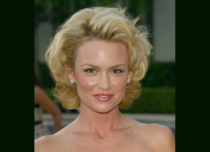 Kelly Carlson with short curled hair
